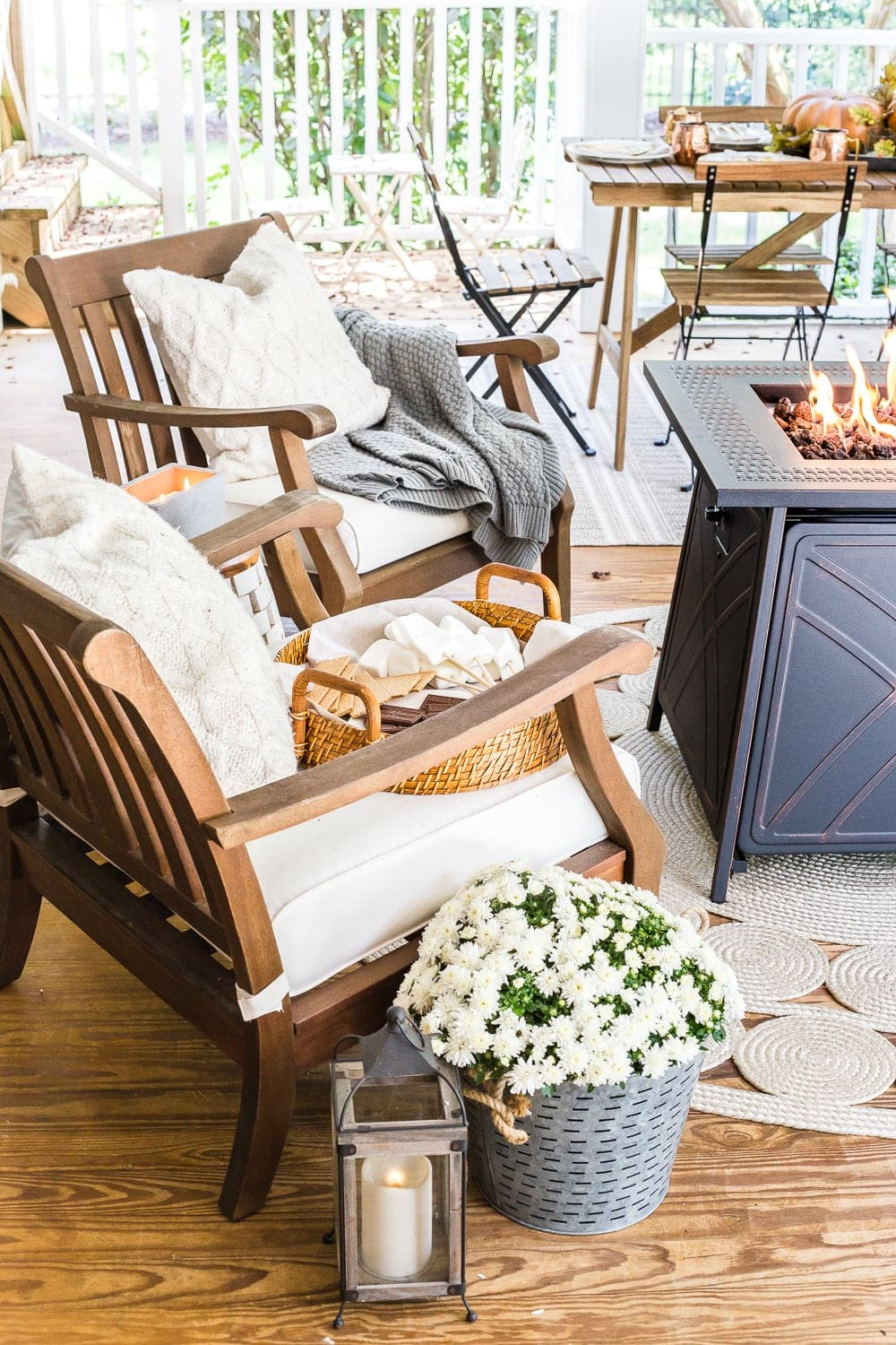 Cozy fall back porch with neutral outdoor furniture and fire pit