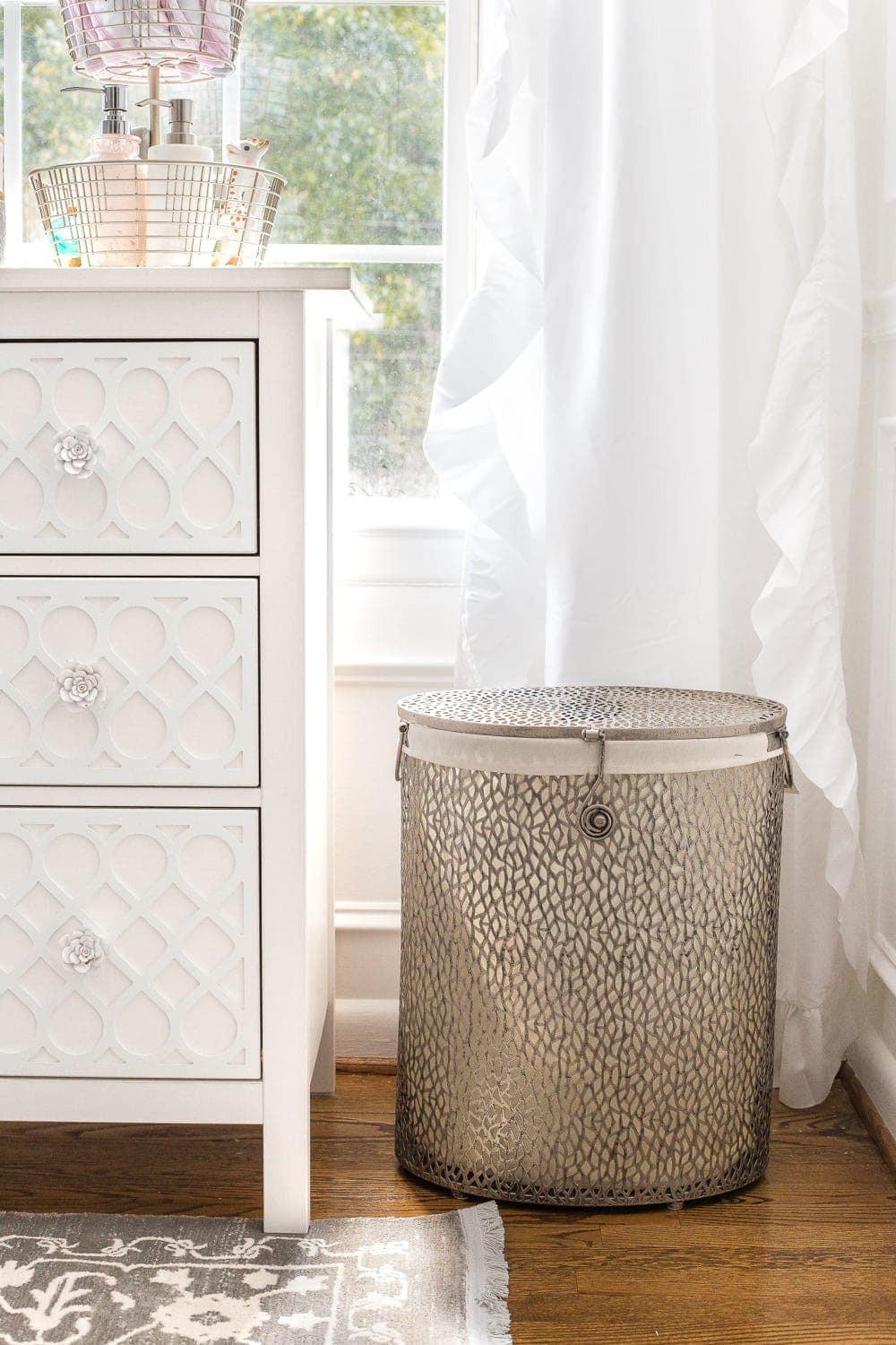Nursery Organization | Use a lidded hamper with a liner for easy washing and to contain baby smells.