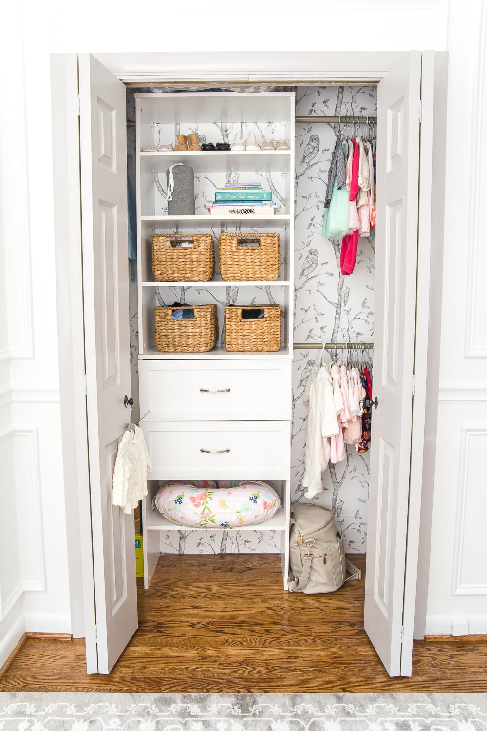 Nursery Organization | Baby closet with shelving, baskets, and closest dividers to make it easy to find everything.