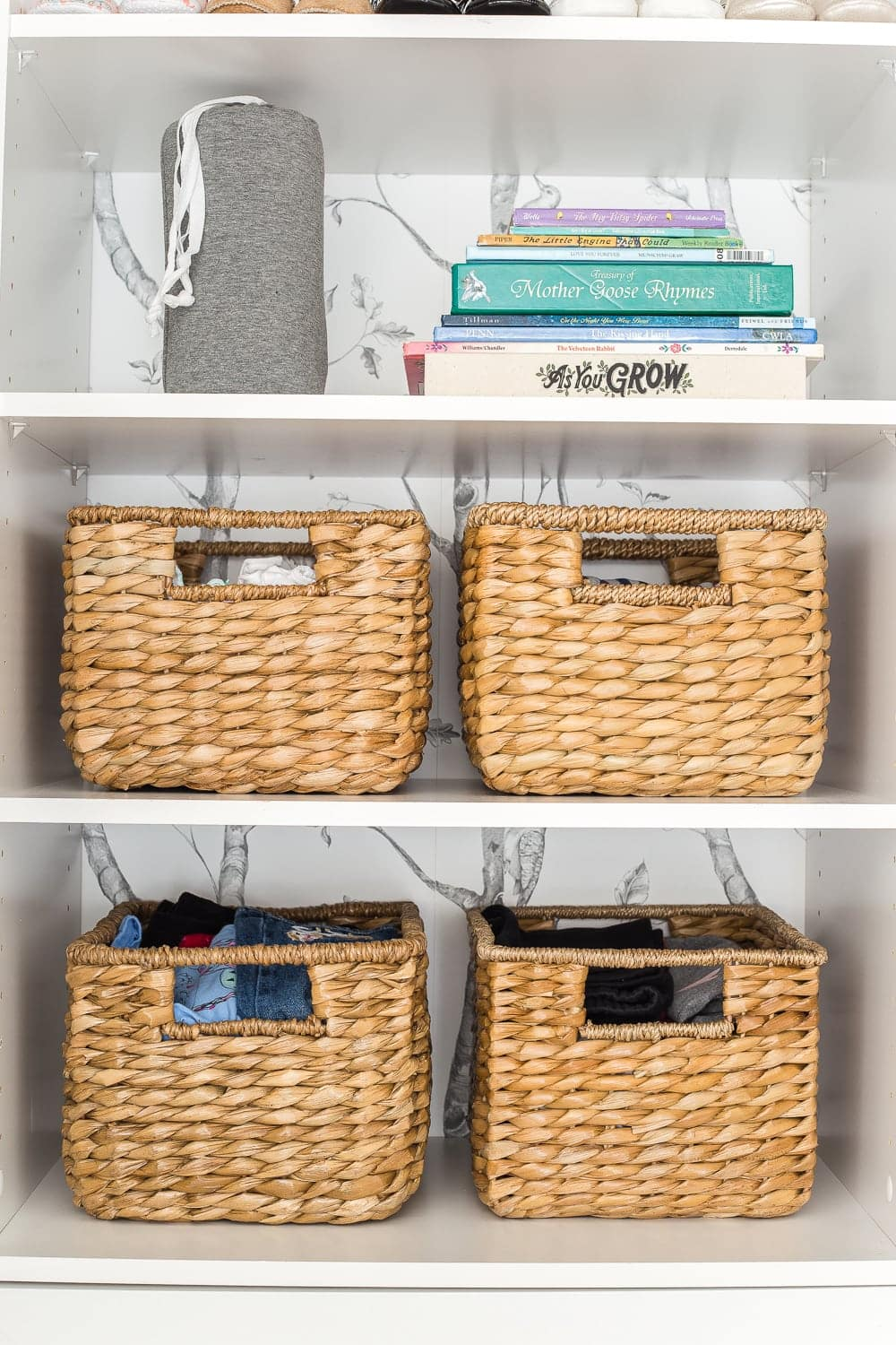 Nursery Organization | Closet shelves to hold next phase size clothing and baby books for story time.