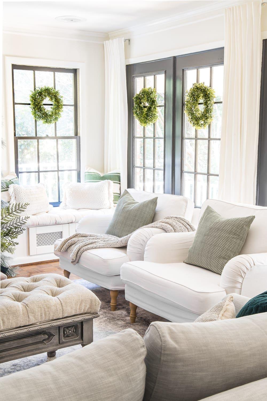 Christmas wreaths hanging on windows