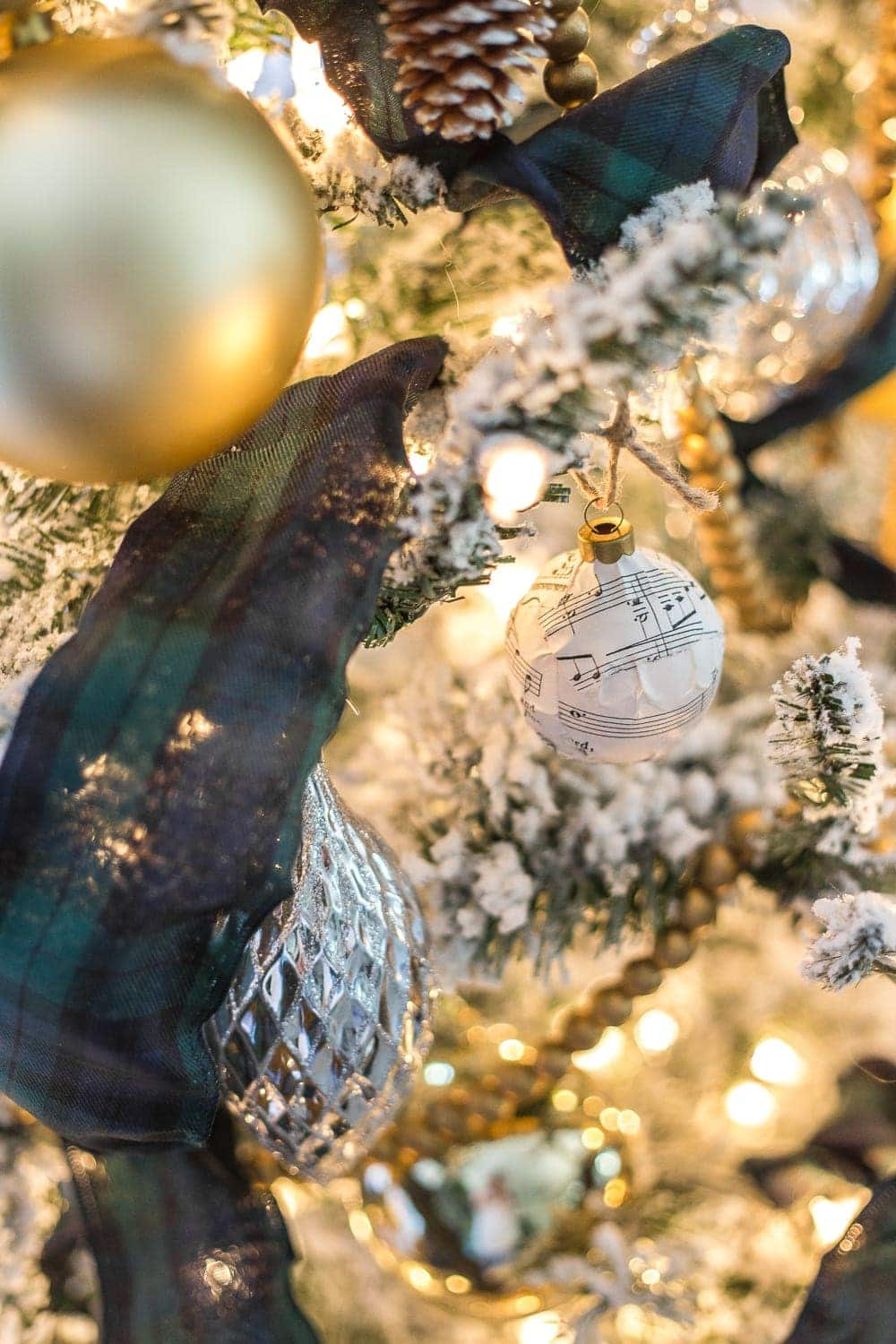 Thrifty Christmas decorating idea: Mod Podge old sheet music on cheap ball ornaments to make