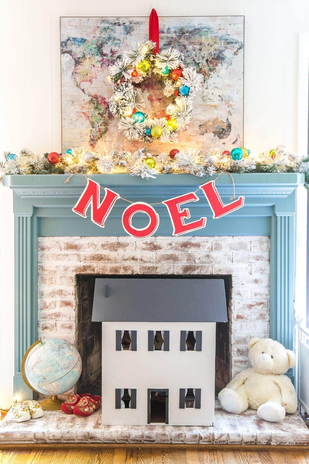 Playroom fireplace and mantel decorated for Christmas