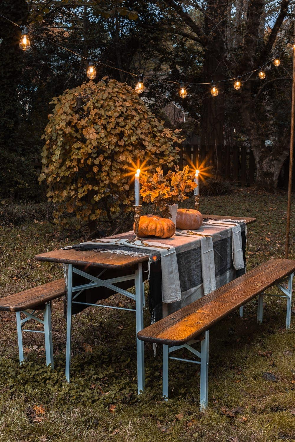 Beer garden table with string lights for fall