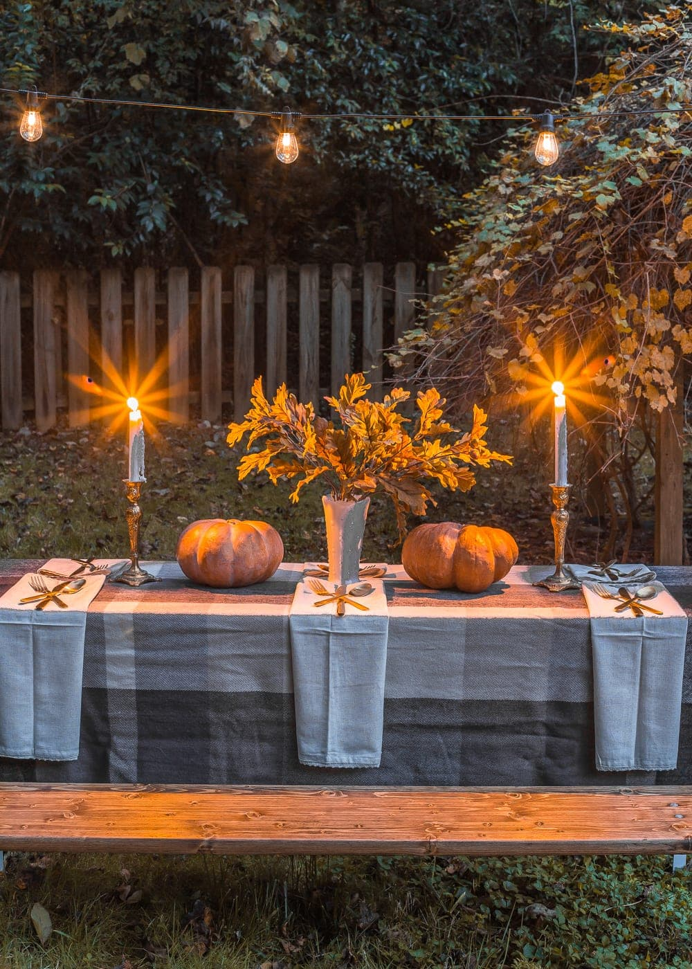 Outdoor Thanksgiving beer garden table with string lights