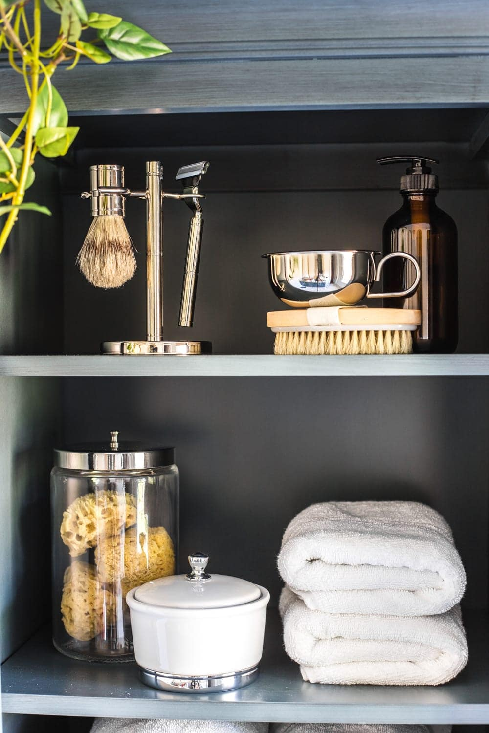 How to Turn a Cabinet Into a Hamper in Seconds | bathroom linen cabinet tower with styled shelves