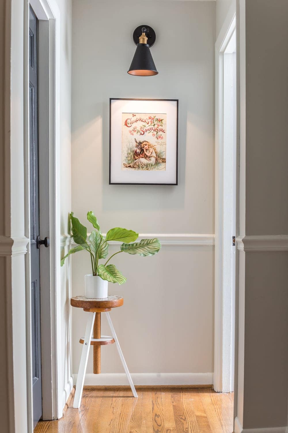 6 Tips to Decorate a Boring Hallway | blesserhouse.com - hallway art and magic light trick wall sconce accent lighting