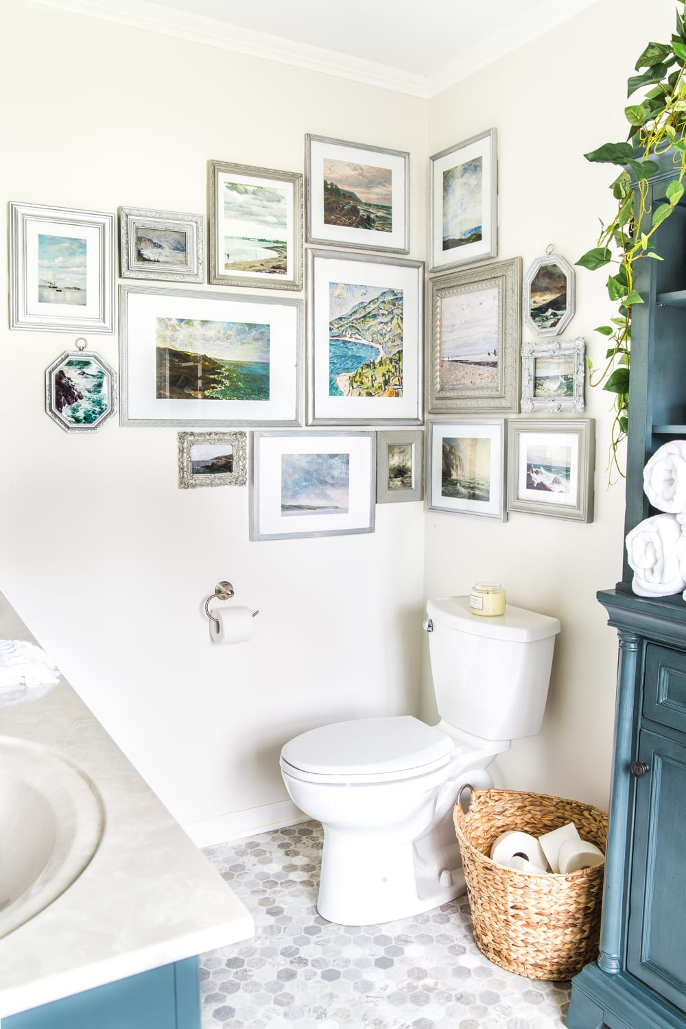 Budget Master Bathroom Refresh Reveal | corner gallery wall with thrifted frames and free coastal art printables