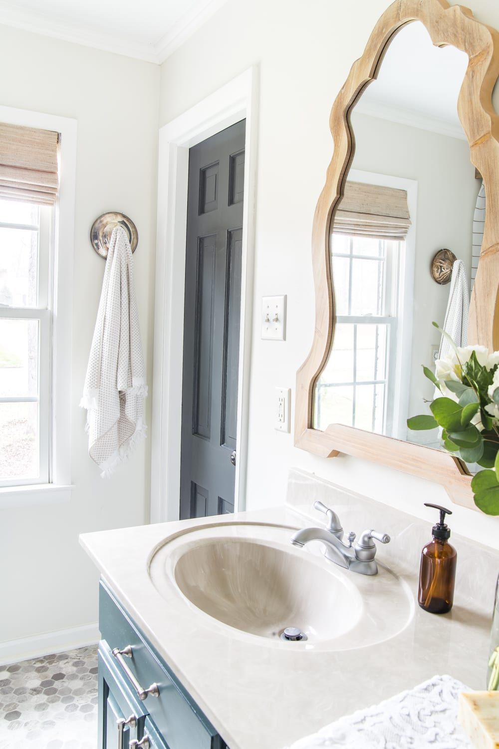 Budget Master Bathroom Refresh Reveal | paint colors: Benjamin Moore Wrought Iron and Benjamin Moore White Dove