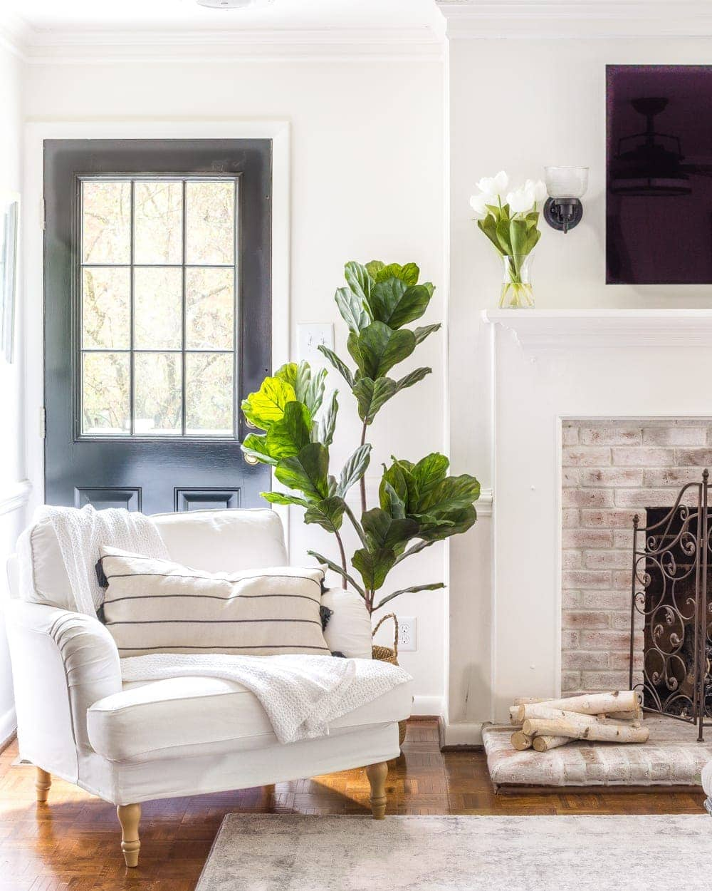 Simple Spring Home Tour | Neutral living room decorated with artificial fiddle leaf fig and IKEA furniture