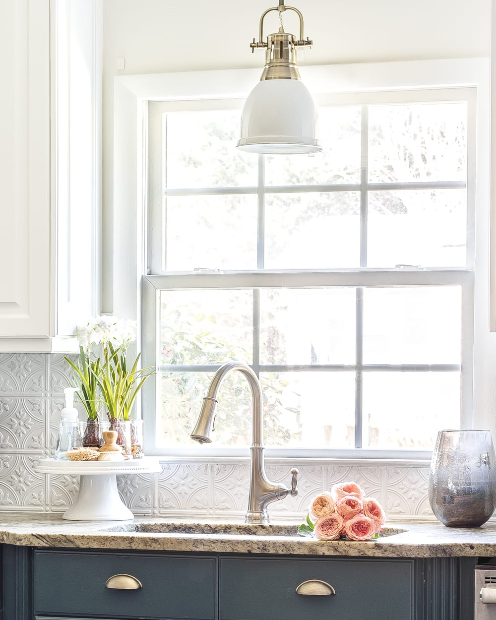 How to Disguise the Ugly Stuff in Your Home   Put scrub brushes and soaps on a cake stand beside the kitchen sink.