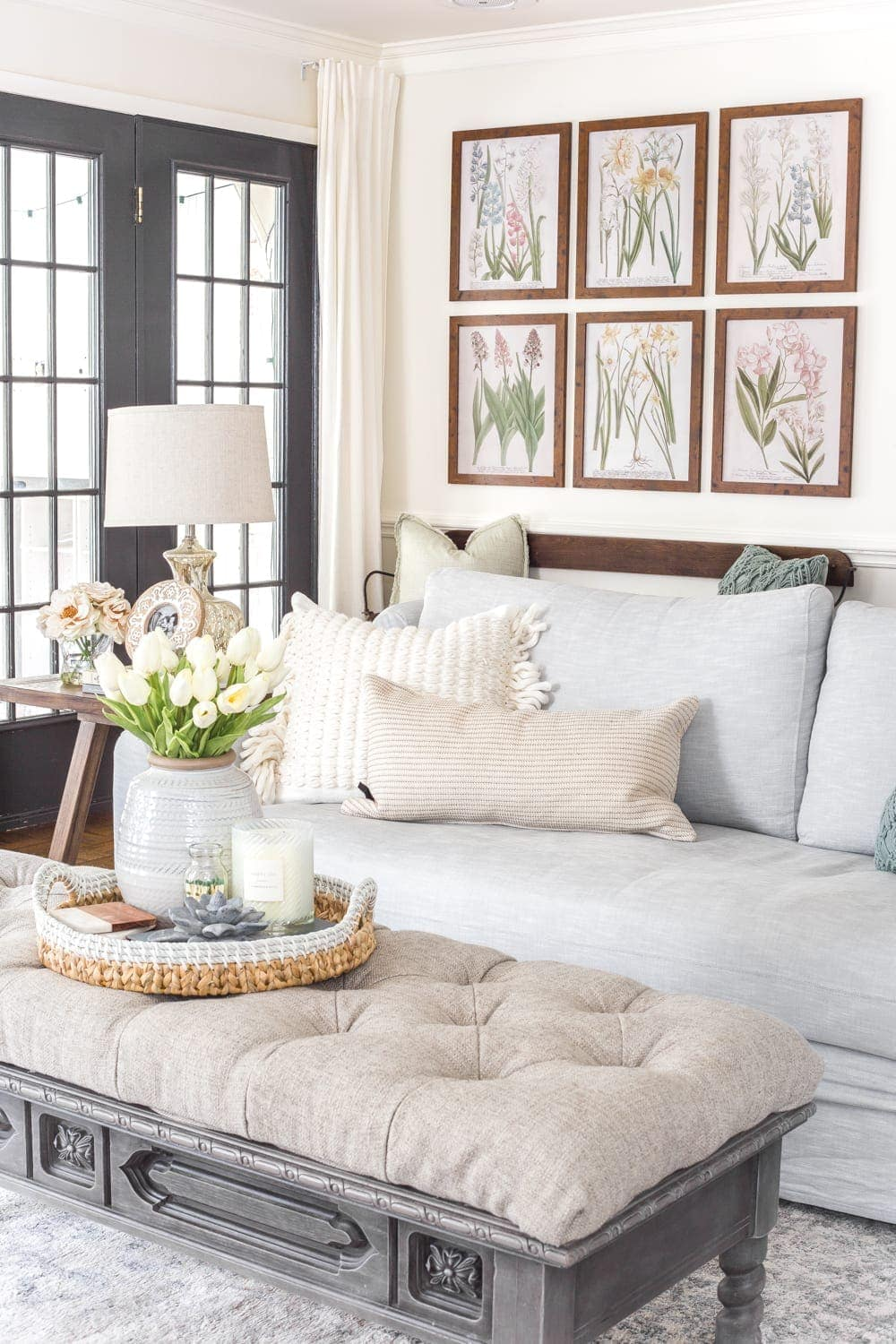 Simple Spring Home Tour | Neutral living room with artificial florals and small spring touches.