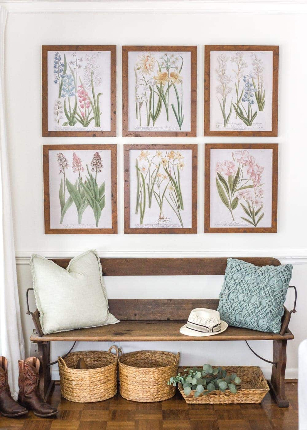 Simple Spring Home Tour | Craigslist bench with baskets underneath for a makeshift mud room and free botanical prints for spring.