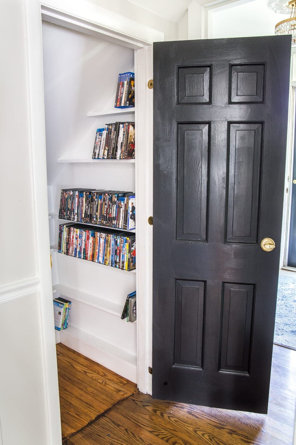 DIY DVD Storage Closet Under the Stairs