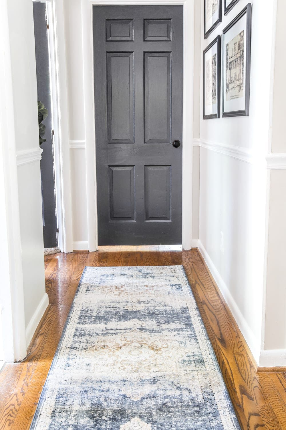 6 Tips to Decorate a Boring Hallway | blesserhouse.com - dark charcoal doors and hallway runner