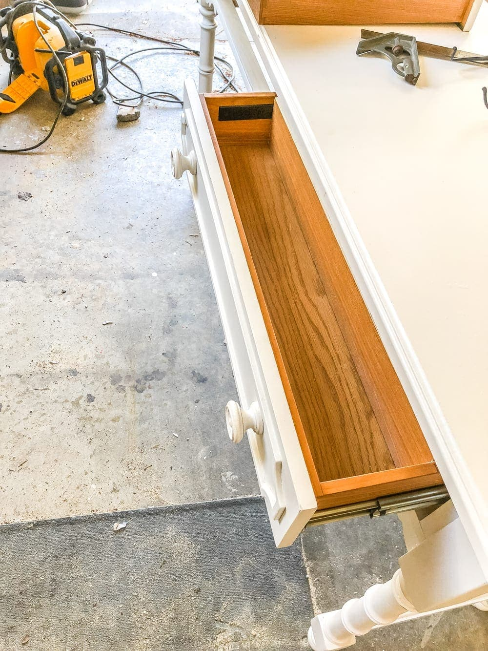 How to Turn a Console Table Into a Bathroom Vanity | blesserhouse.com - A tutorial for how to reconstruct a console table to repurpose as a bathroom vanity and leave drawers functional underneath sinks.