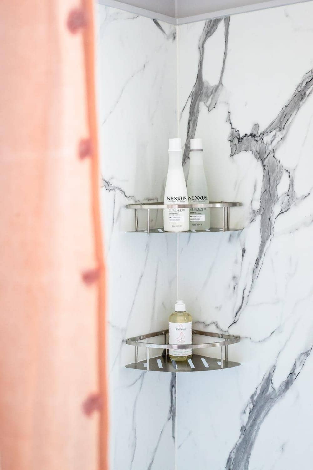 Whimsical, classic kids bathroom makeover | faux marble shower walls