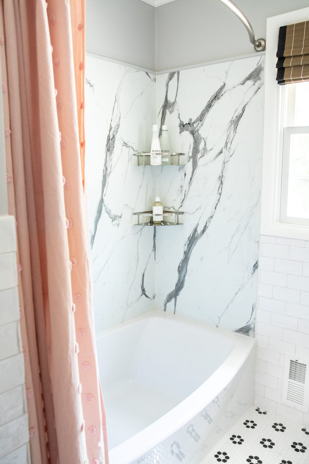 Whimsical, classic kids bathroom makeover | faux marble shower walls from American Standard Passage Collection