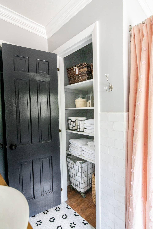 Whimsical, classic kids bathroom makeover | linen closet organization