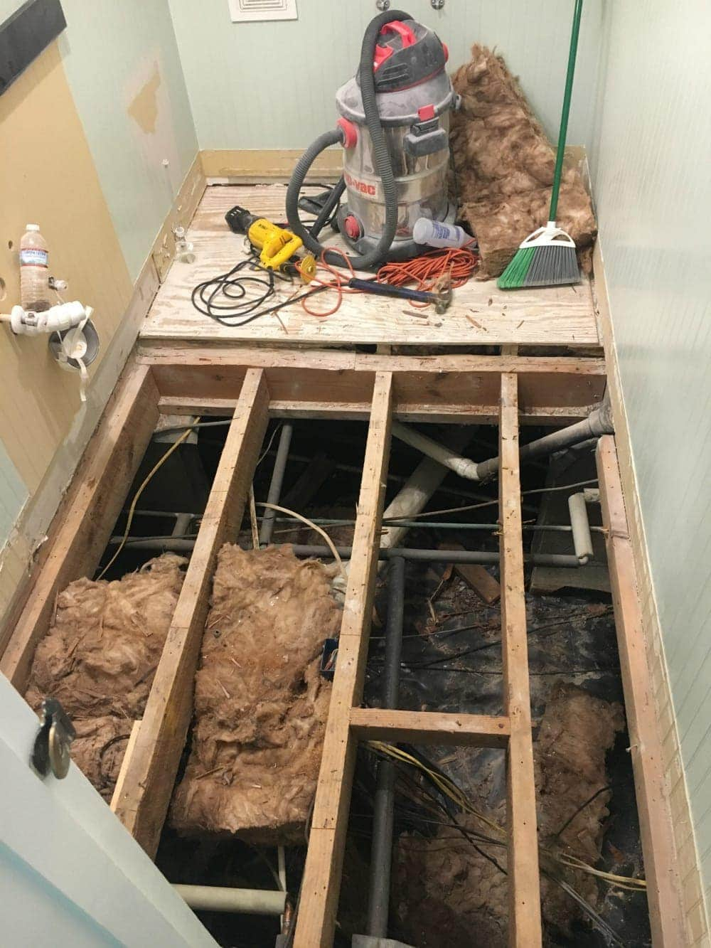 Questions to always ask before hiring contractors - a ripped out bathroom floor