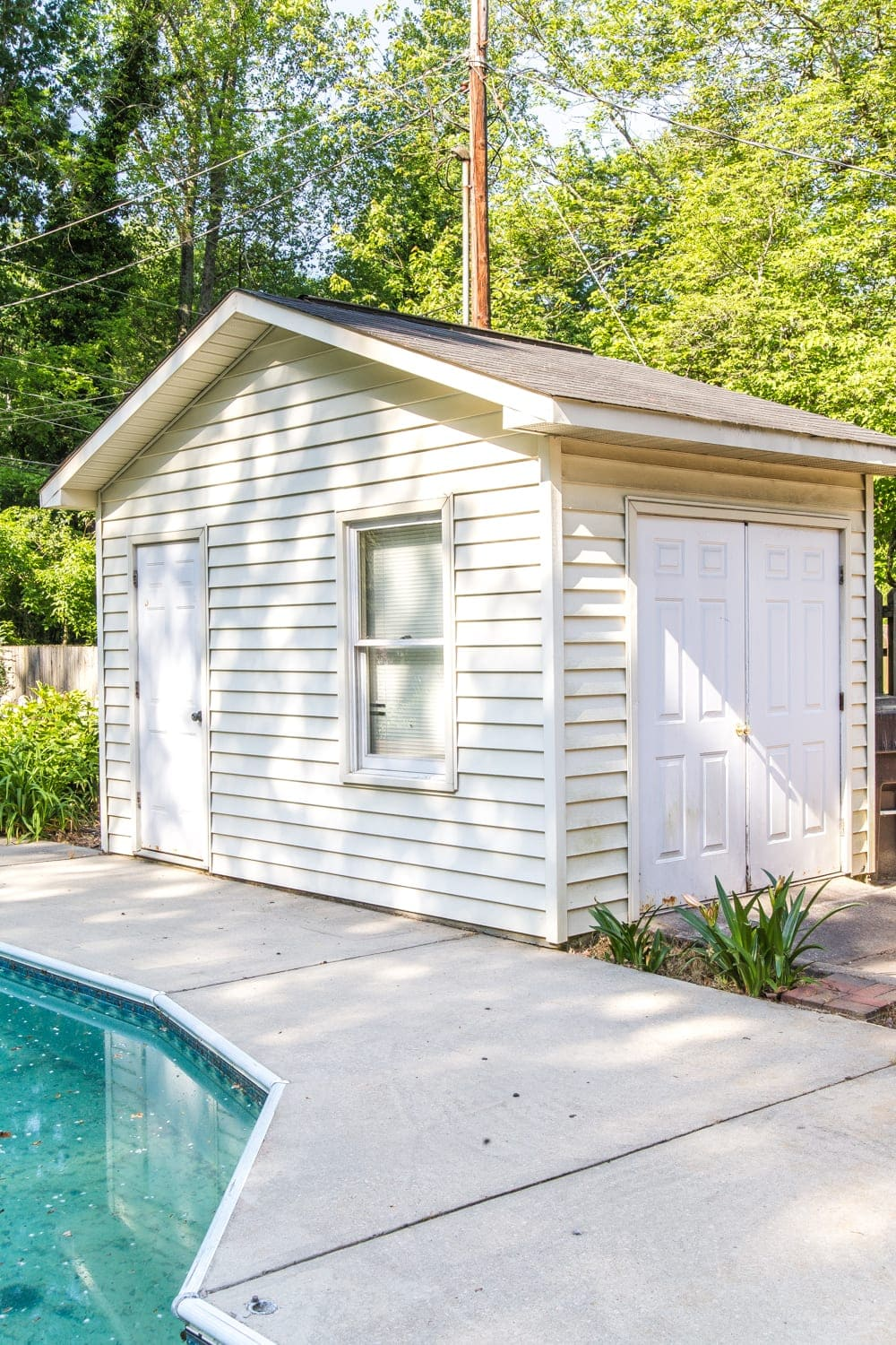 How to Paint Vinyl Siding & Pool Shed Makeover - Bless'er House