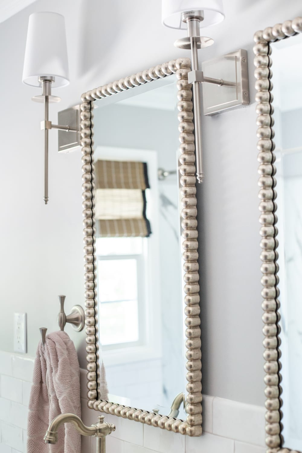 Girls' Bathroom Decor Details & Sources | brushed nickel beaded mirrors and shaded sconces