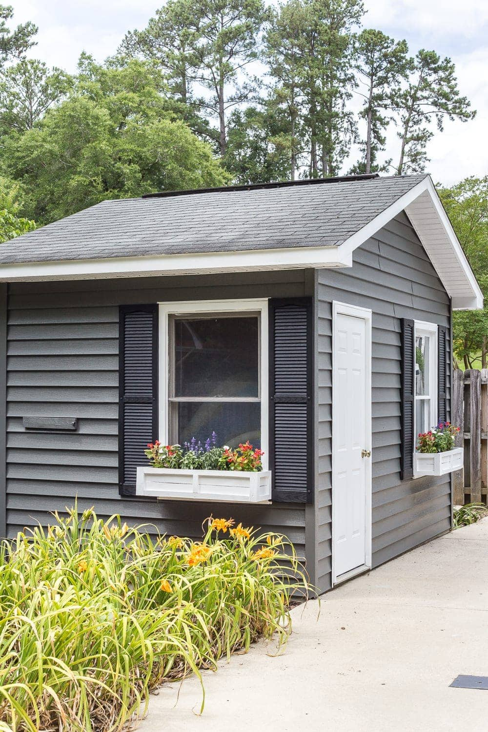 Inexpensive pool shed makeover using vinyl siding paint in Sherwin Williams Pepper Shake + DIY window boxes made from repurposed scrap wood