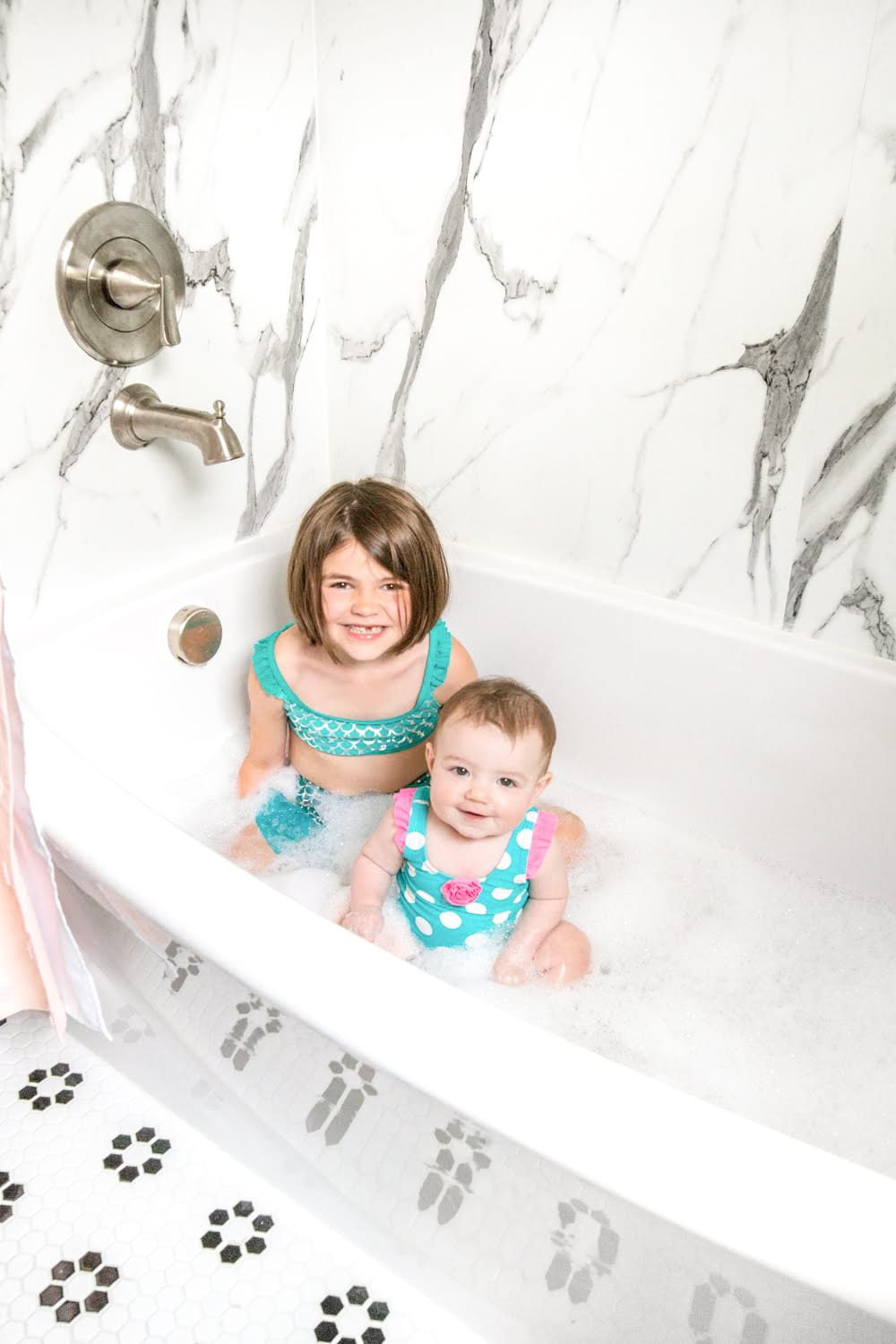 Whimsical, classic kids bathroom makeover | faux marble shower walls from American Standard