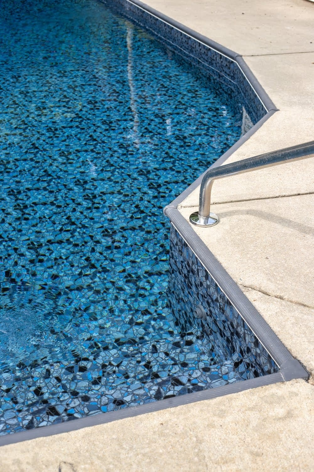 Swimming Pool Liner Makeover Reveal | TrueStone Collection - Obsidian from GLI Pool Products and charcoal gray painted coping strip