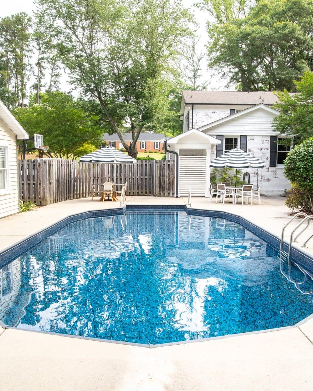 Swimming Pool Liner Makeover Reveal | Obsidian pool liner from GLI Pool Products TrueStone Collection and limewashed brick
