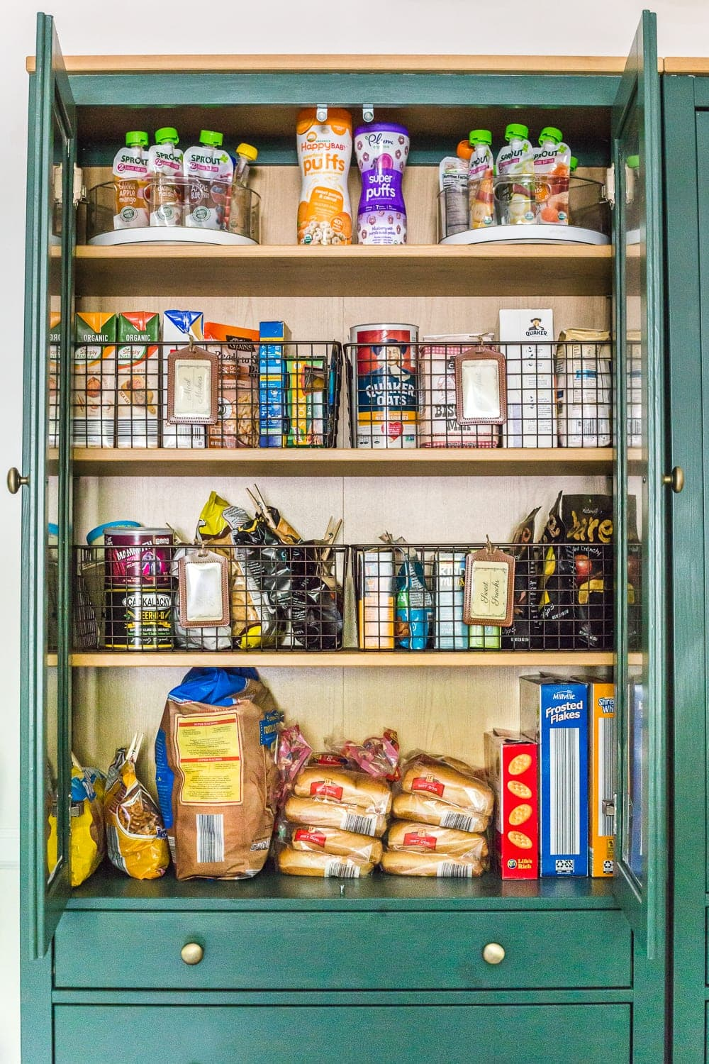 IKEA Hemnes Pantry Cabinet Organization - Tips and ideas for maximizing storage and creating function for food storage in a cabinet to repurpose as a pantry. #pantryorganization
