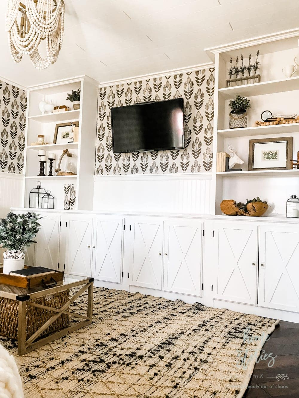 Put up pretty wallpaper behind a TV. A little pattern can go a long way and make your TV look cute in the process.