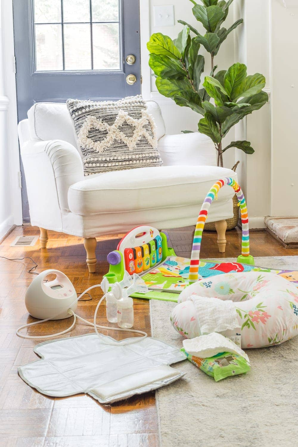 """Exclusive Pumping Hack - set up a """"cockpit"""" on the floor with a pump, Boppy for propped bottle feeding, diaper changing pad, and play mat."""