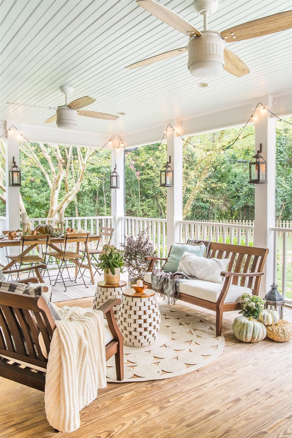 Natural wood and white modern cottage style ceiling fans on a back porch