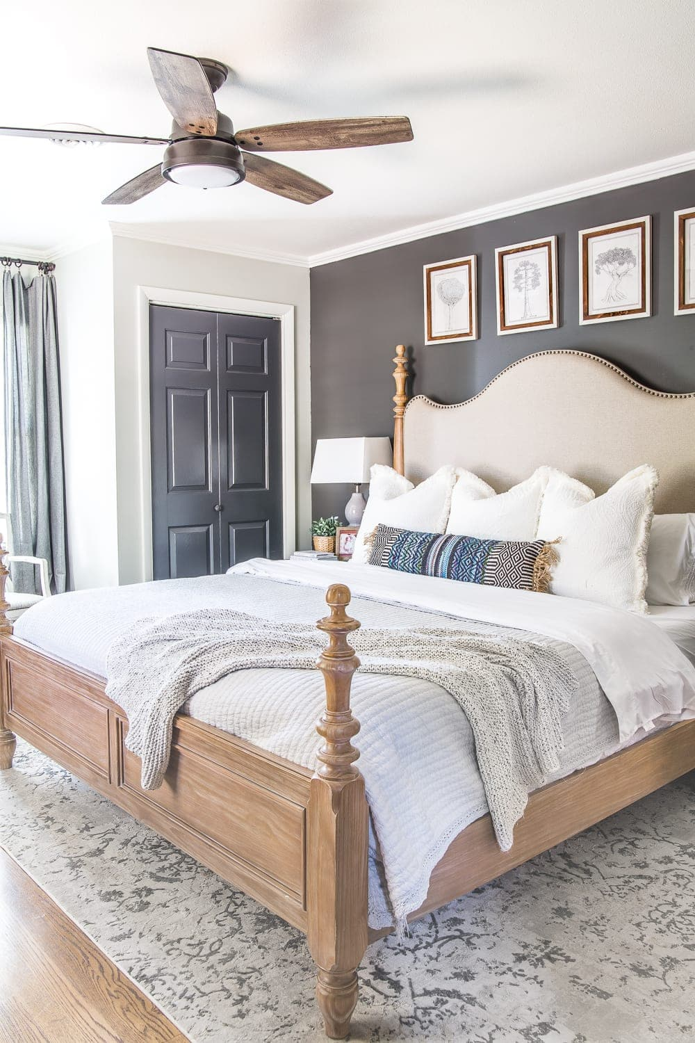 Modern rustic ceiling fan in a master bedroom