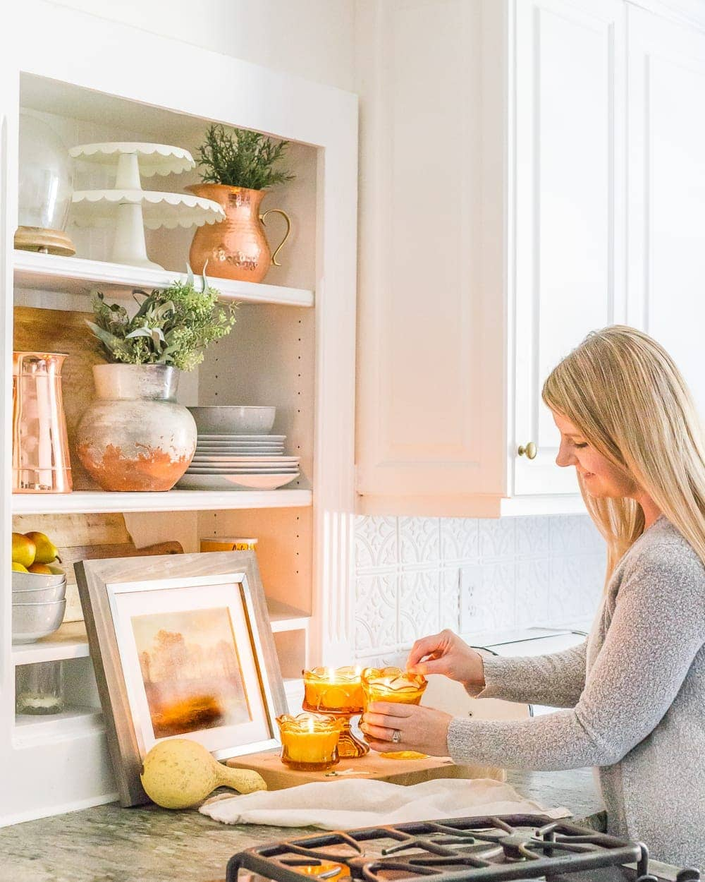 kitchen shelves and amber glass candles