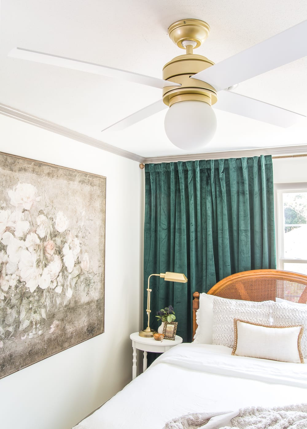 Gorgeous matte brass modern ceiling fan in a bedroom