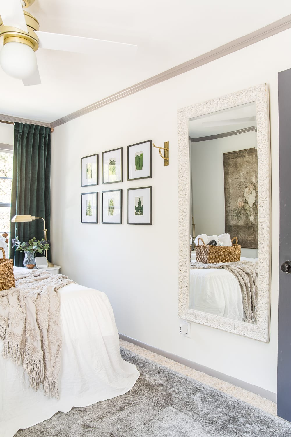 38 Guest Bedroom Essentials | Hang up a full-length mirror and keep a wall hook handy for robes, towels, or bags.
