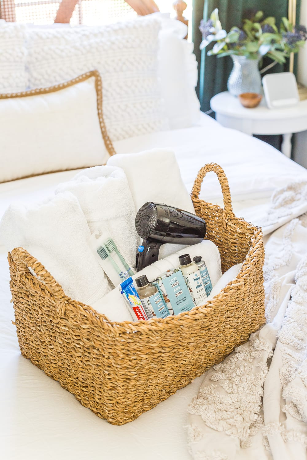 38 Guest Bedroom Essentials | Have a basket with extra towels and extra toiletries in case guests forget any.