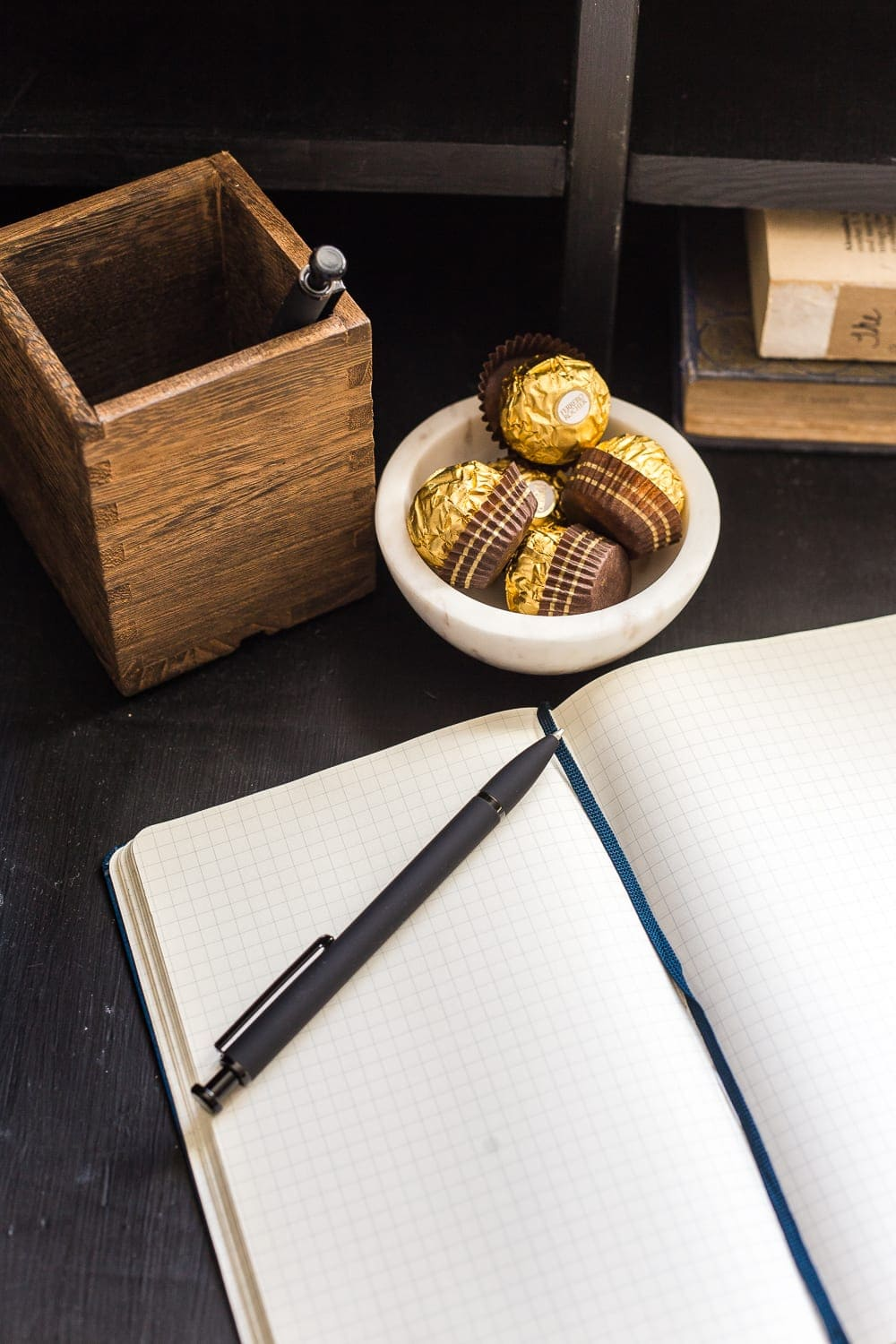 38 Guest Bedroom Essentials | Keep a notepad and pen handy along with a few chocolates to treat your guests.