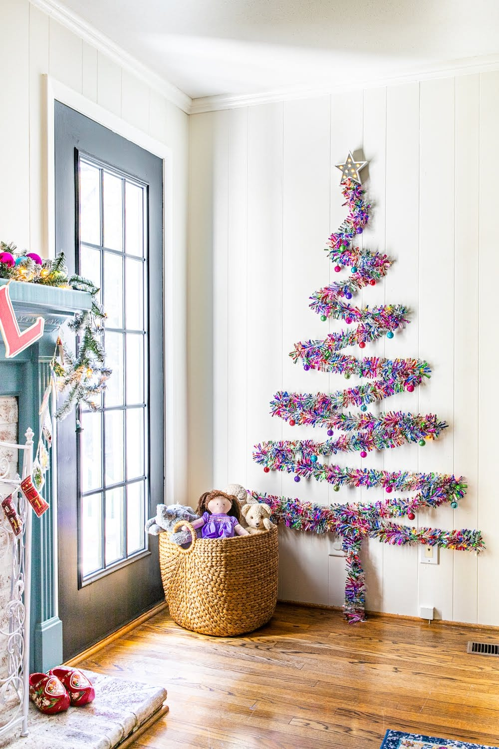 DIY wall Christmas tree with just Command hooks, garland, fairy lights, and shatterproof ornaments