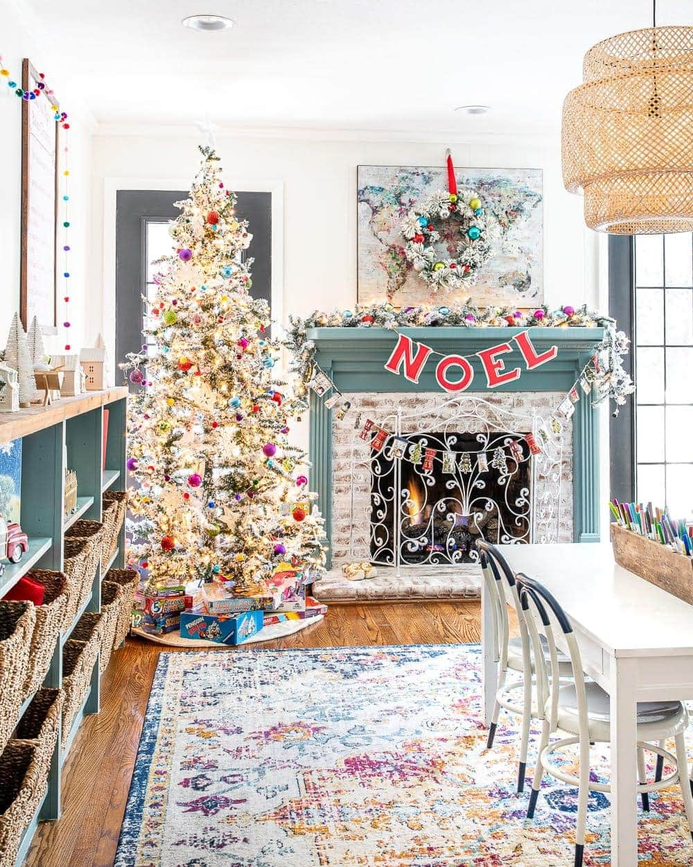 Colorful Christmas Playroom | 4 Christmas decorating tricks for hanging garlands, wreaths, banners, art, lights, and more without damaging furniture or walls.