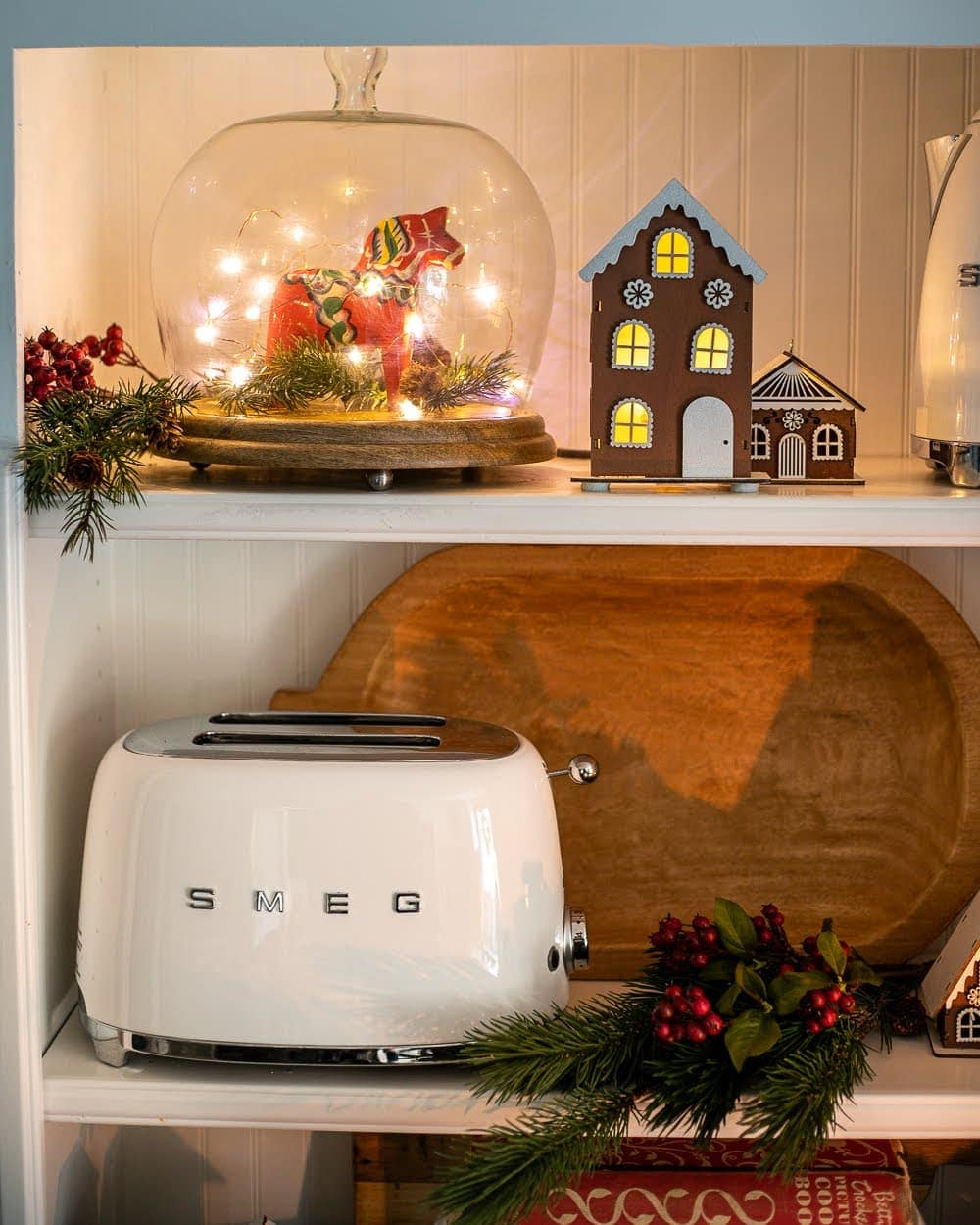 Swedish Christmas kitchen shelves styled with Dala horse and gingerbread