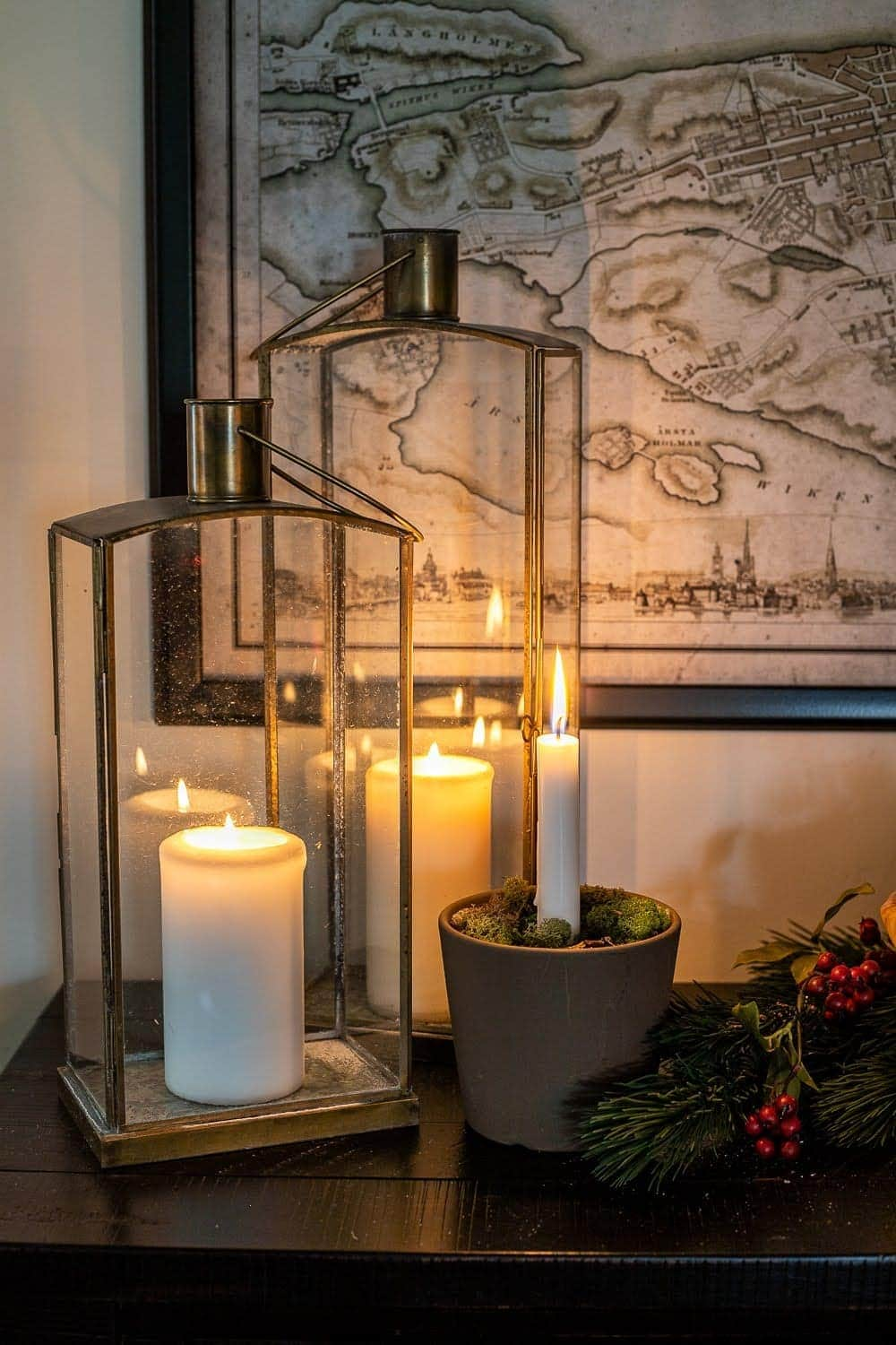 Add lanterns and candlelight to your Christmas decor to create hygge in your home.
