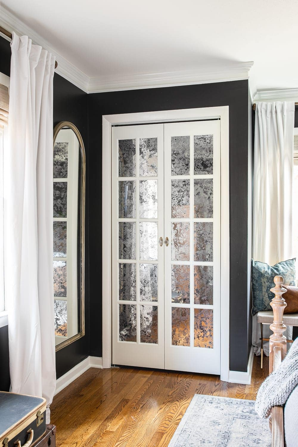 Mirrored French Closet Doors | How we created a vintage style, glamorous solution for our bifold doors on our master bedroom's his and her closets for added light and texture. #closetdoor #bifolddoor #vintagedoor