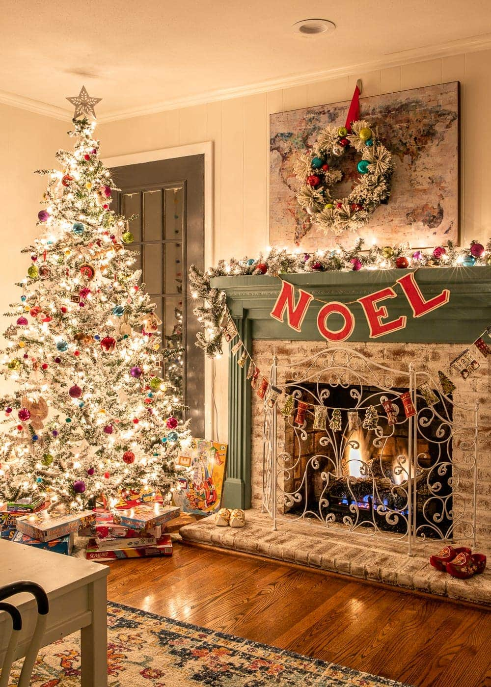 Christmas playroom at night with fireplace and tree