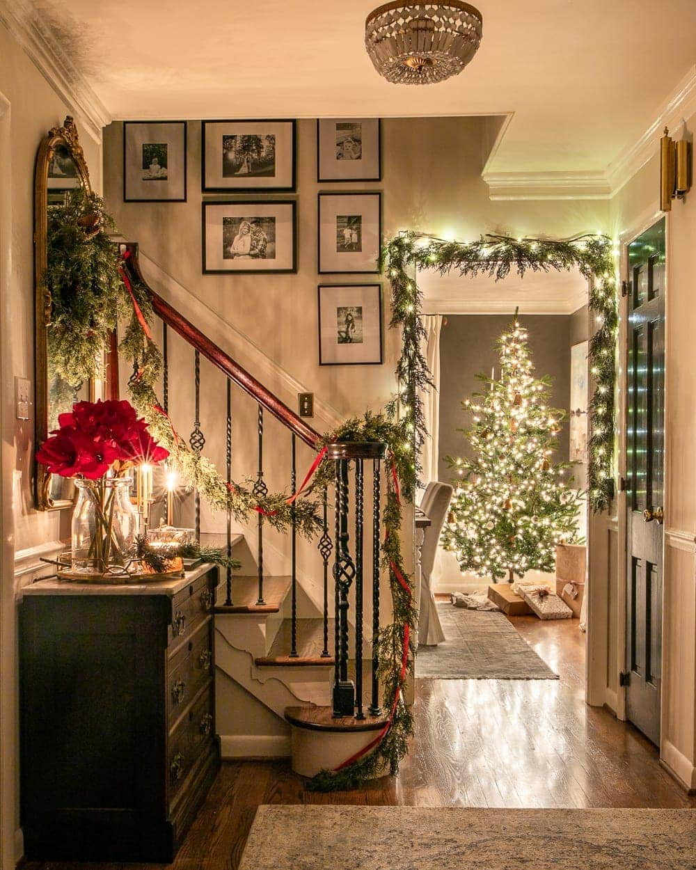 Christmas foyer and dining room at night with twinkle lights and candlelight