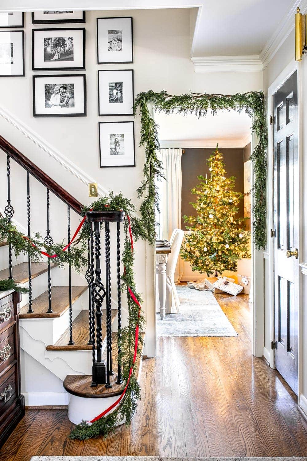 Christmas decor ideas   Modern meets traditional Christmas foyer with real looking faux garland