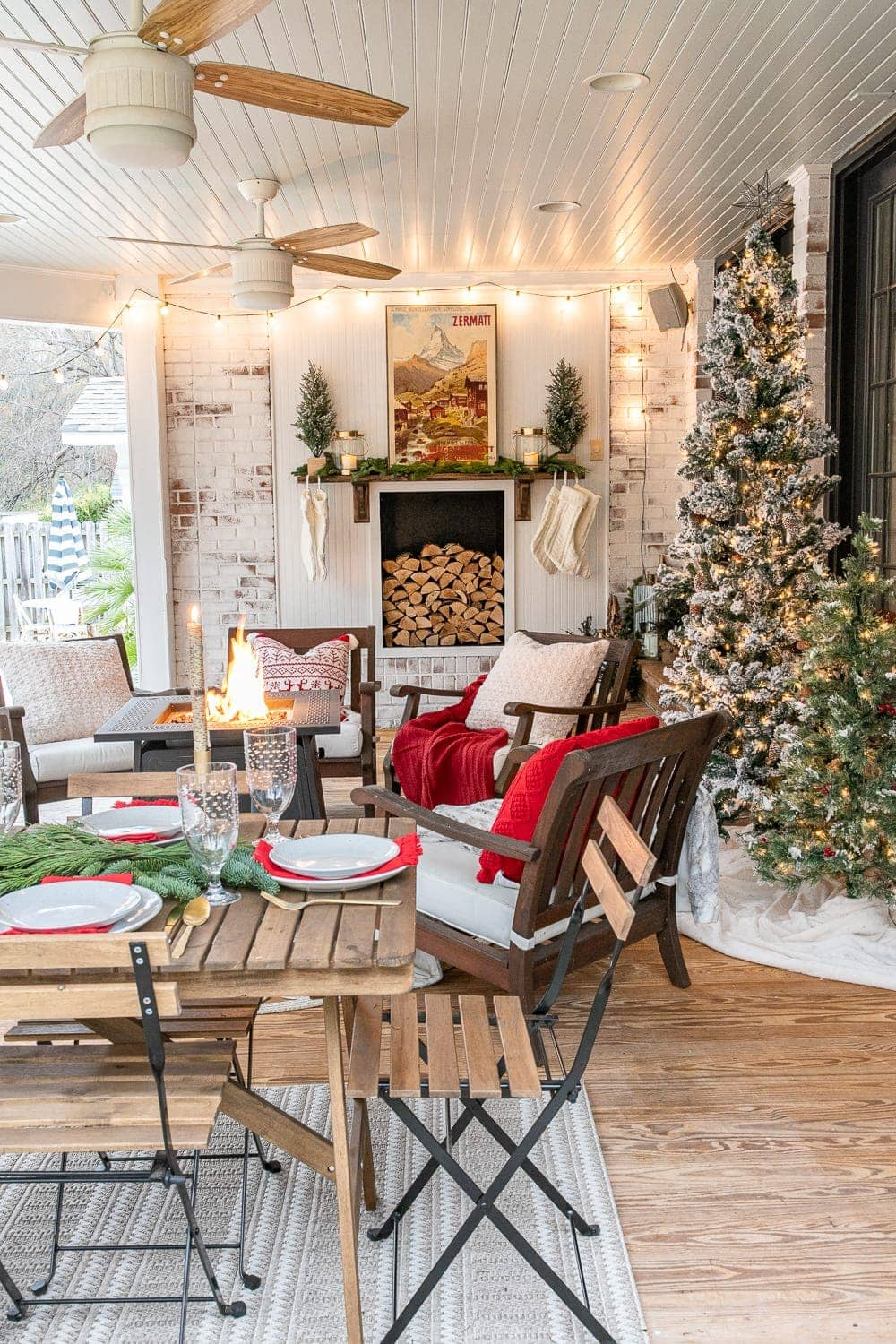 Cozy Christmas back porch with faux fireplace and fire pit