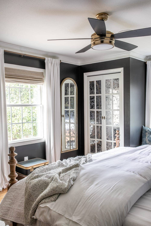 master bedroom with bifold closet doors